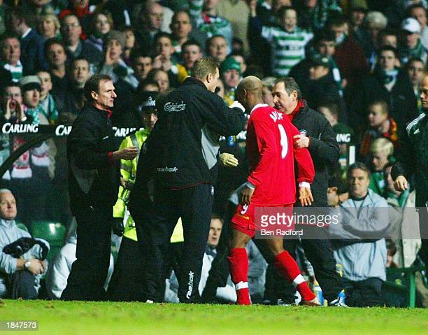 El Hadji Diouf of Liverpool leaves the field after his incident in the crowd during the Glasgow Celtic v Liverpool UEFA Cup Quarter Final match at...