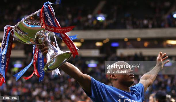 El Hadji Diouf of Rangers lifts the Cooperative Insurance Cup after beating Celtic in the final at Hampden Park on March 20 2011 in Glasgow Scotland