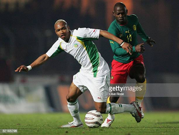 El Hadji Diouf of Senegal is tackled by Achile Emana of Cameroon during the International friendly match between Cameron and Senagal at Stade...