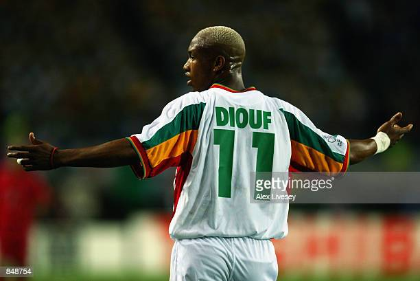 El Hadji Diouf of Senegal protests to the officials during the FIFA World Cup Finals 2002 Quarter Finals match between Senegal and Turkey played at...