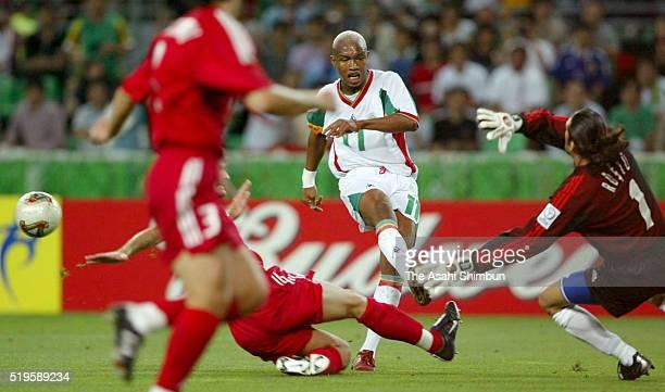 El Hadji Diouf of Senegal shoots at goal during the FIFA World Cup Korea/Japan quarter final match between Senegal and Turkey at the Nagai Stadium on...