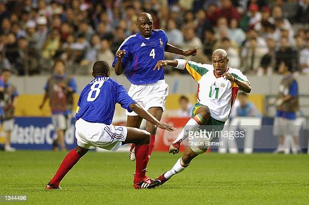 El Hadji Diouf of Senegal takes the ball round Marcel Desailly of France during the France v Senegal Group A World Cup Group Stage match played at...