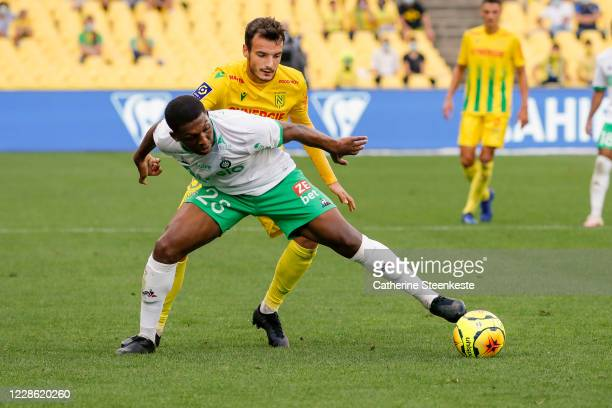 El Hadji Diousse of AS Saint-Etienne controls the ball against Pedro Chirivella of FC Nantes during the Ligue 1 match between FC Nantes and AS...