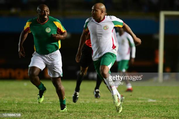 El Hadji Ousseynou Diouf from Team Generation 2002 plays against Emmanuel Amunike during the match of the Legends in homage of Jules Francois Bocande...