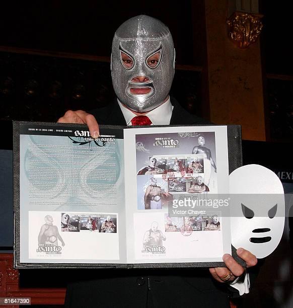 """El Hijo del Santo attends """"El Santo 25th Anniversary"""" Mexico postal service stamps first day issue cancellation at Palacio de Correos on June 19,..."""