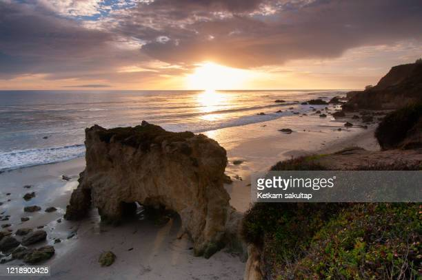 el matador beach at sunset, malibu, california. - malibu beach stock pictures, royalty-free photos & images