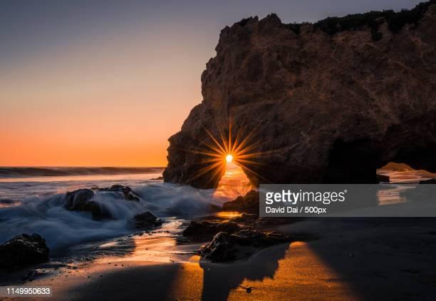 el matador beach sunset - malibu beach stock pictures, royalty-free photos & images