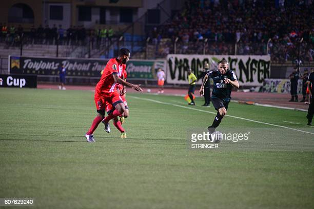 El Mehdi El Bassil of FUS RabatYoucef Grey Laid Touti of MO Bejaia go headtohead in the first leg of the 2016 Caf Confederation Cup semifinal at the...