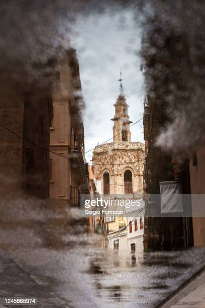 el miguelete reflected on a puddle - valencia stock pictures, royalty-free photos & images