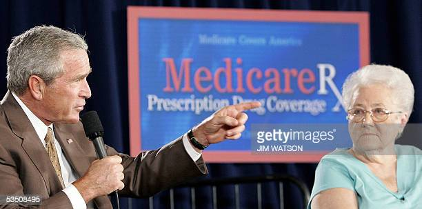 US President George W Bush speaks on the Medicare drug plan as 82yearold Margaret Cantrll looks 29 August 2005 at the Pueblo El Mirage RV Resort and...
