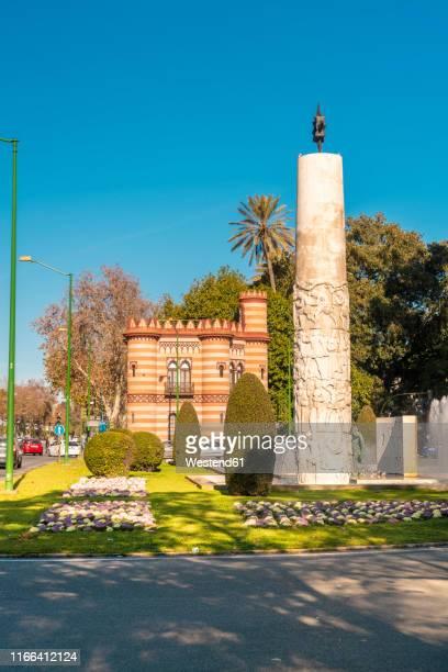 el monumento a juan sebastian elcano and costurero de la reina, seville, spain - juan sebastian elcano stock photos and pictures