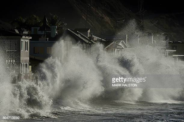 TOPSHOT El Nino generated storm waves crash onto seaside houses at Mondos Beach California on January 12 2016 Californians are now experiencing a...