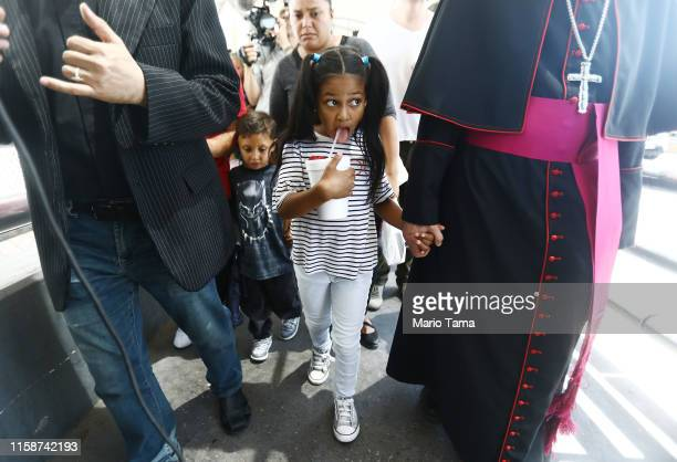 El Paso Bishop Mark Seitz escorts Celsia Palma from Honduras as they cross the Paso Del Norte Port of Entry bridge towards the US on June 27 in...