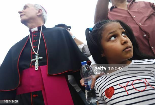 El Paso Bishop Mark Seitz prepares to escort Celsia Palma from Honduras before they cross the Paso Del Norte Port of Entry bridge towards the US on...