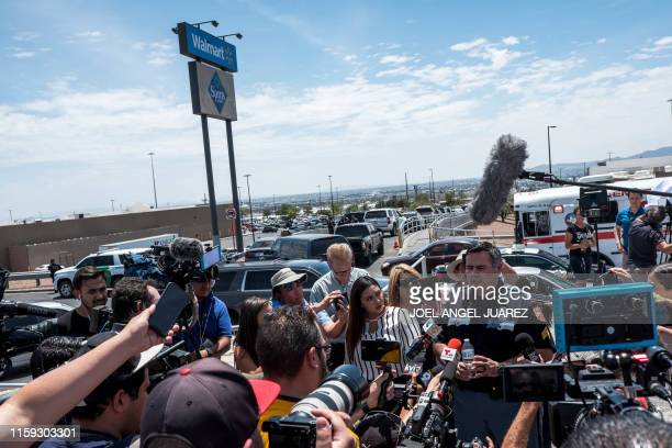 TOPSHOT El Paso Police Department Sgt Robert Gomez briefs media on a shooting that occurred at a WalMart near Cielo Vista Mall in El Paso Texas on...