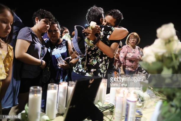 El Paso resident Manny Diaz is hugged at the conclusion of a vigil for victims of a mass shooting which left at least 20 people dead on August 4 2019...
