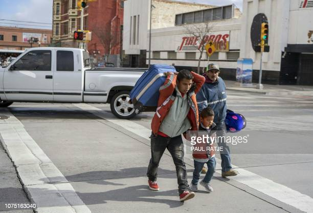 El Paso resident Mario Rodriguez assists a Guatemalan father and son who couldnt find the Greyhound bus station in downtown El Paso Texas on December...