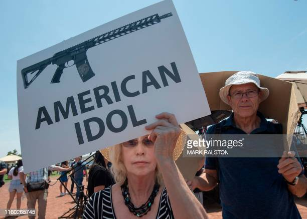 TOPSHOT El Paso residents protest against the visit of US President Donald Trump to the city after the Walmart shooting that left a total of 22...