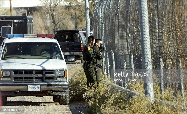 US Customs and Border Patrol agents keep watch on a creek separating the US and Mexico as the motorcade of US President George W Bush passes by 29...