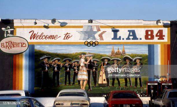 El Ranchito in Los Angeles, California has a mural commemorating the 1984 Los Angeles Olympics covering the side of the building, 1987.