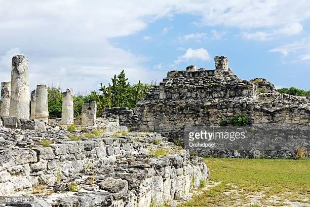 El Rey Ruins on bright green grass under blue sky in Cancun.