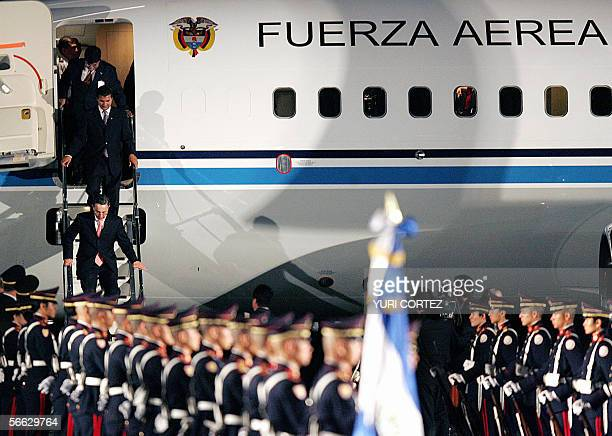 Colombian President Alvaro Uribe downstairs from his plane as he arrives for a welcoming ceremony 19 January 2006 at the El Salvador's International...