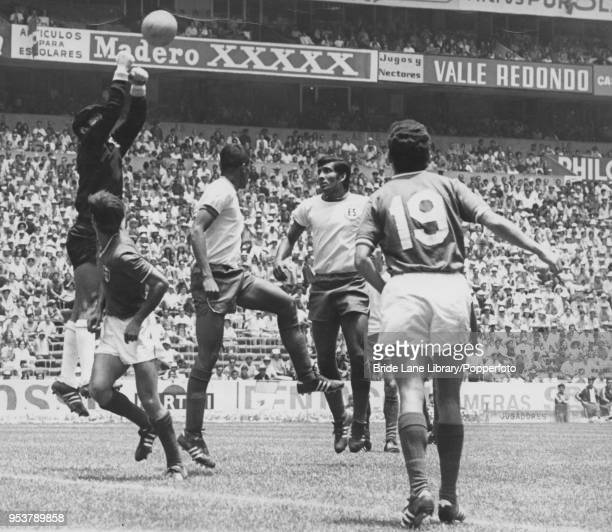 El Salvador goalkeeper Raúl Magaña punches the ball clear in a World Cup Group 1 match against Mexico at the Estadio Azteca in Mexico City 7th June...