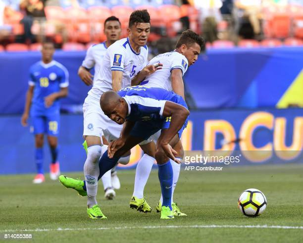 El Salvador players tackle Rangelo Janga of Curazao during the El Salvador vs Curacao CONCACAF Group C Gold Cup soccer game on July 13 2017 at Sports...