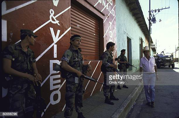 El Salvadoran soldiers patrolling during time of guerrilla violence