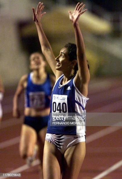 El Salvadorean athlete Veronica Quijano reaches the finish line in Guatemala City 29 November 2001 La velocista Salvadorena Veronica Quijano celebra...