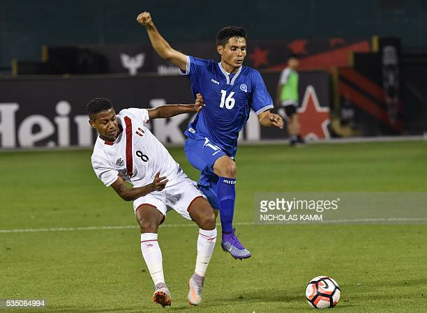 El Salvador's Andres Flores vies with Peru's Andy Polo during an international friendly football match at RFK Stadium in Washington DC on May 28 2016...