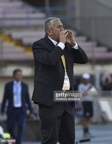 El Salvador's coach Eduardo Lara gestures during the match against Honduras for the Central American Football Union tournament in Panama City on...