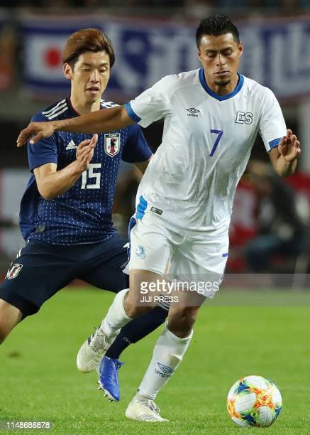 El Salvador's Darwin Ceren dribbles the ball in front of Japan's Yuya Osako during their friendly football match between Japan and El Salvador at...