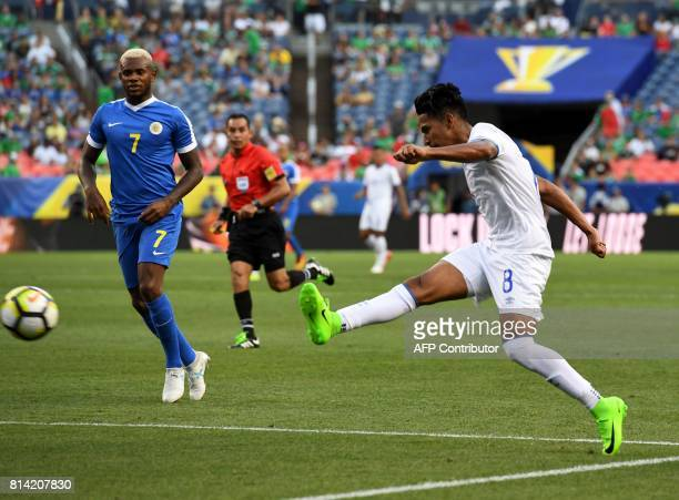 El Salvador's Denis Pineda takes a shot for goal watched by Curazao's Leandro Bacuna in their Group C game during the 2017 CONCACAF Gold Cup at the...