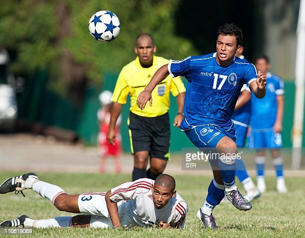 El Salvador's footballer Mark Lester and Cuba's Yenier Marquez Molina vie for the ball during a friendly match in preparation for the CONCACAF Golden...