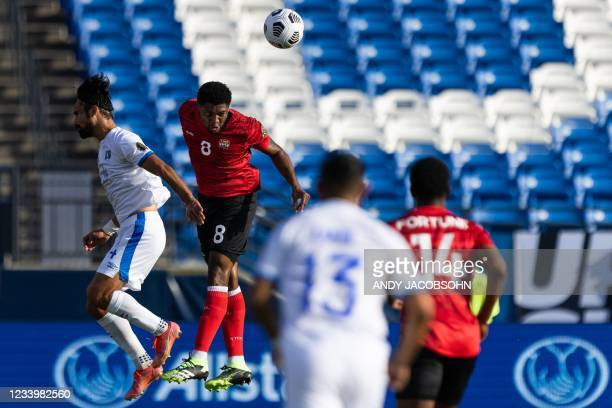 El Salvador's forward Joaquin Rivas and Trinidad and Tobago's defender Mekeil Williams attempt to head the ball during the CONCACAF Gold Cup group...