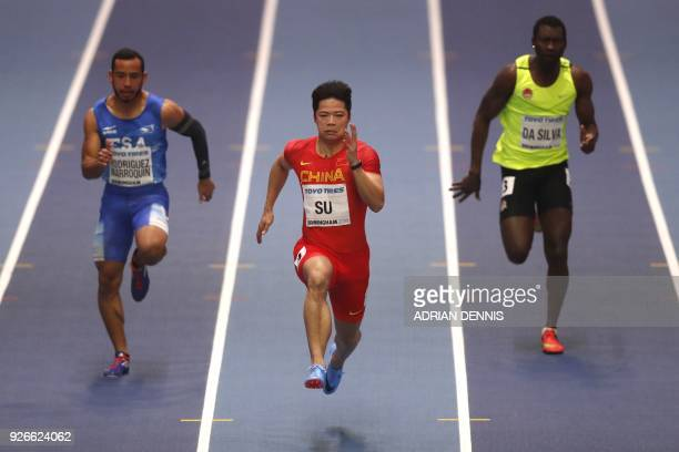El Salvador's Juan Carlos Rodriguez Marroquin China's Su Bingtian and GuineaBissau's Holder da Silva compete in the men's 60m round 1 event at the...