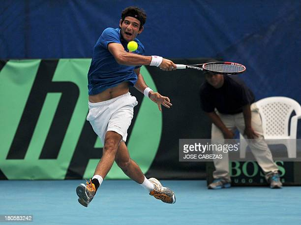 El Salvador's Marcelo Arevalo returns the ball during their Davis Cup doubles match against Venezuela's Luis Martinez and Roberto Maytin on September...