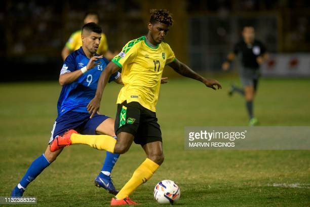 El Salvador's Nelson Bonilla vies for the ball with Jamaica's Damion Lowe during their CONCACAF League of Nations football match on the final date of...