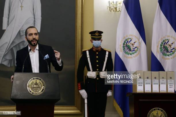 El Salvador's President is photographed next to the files that contain case information The massacre of El Mozote during a press conference at a...