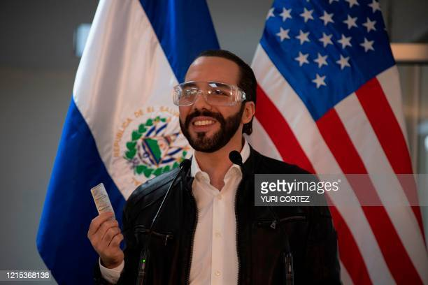 El Salvador's president Nayib Bukele, accompanied by US Ambassador to El Salvador Ronald Johnson , speaks during a joint press conference at Rosales...