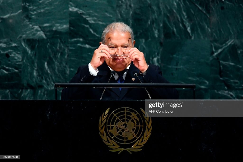 El Salvadors President Salvador Sanchez Ceren wears his glasses before addressing the 72nd Session of the United Nations General assembly at the UN headquarters in New York on September 21, 2017. / AFP PHOTO / Jewel SAMAD
