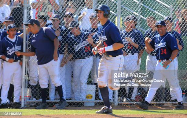 El Segundo baseball beat St. Paul in the CIF-SS Div. IV quarterfinal game. 5th inning. St. Paul's Chris Willson is cheered on by teammates after a...