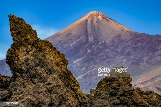 El Teide volcano mountain peak in Tenerife Canary islands of Spain with blue sky and clouds a protected natural park monument attraction and landmark...