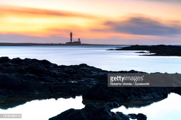 el toston lighthouse at sunset, fuerteventura - atlantic islands stock pictures, royalty-free photos & images