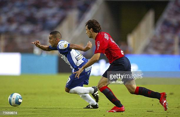 El Yaagoubi Moha of Espanyol and Francisco Juanfran of Osasuna chase down the ball during the Spanish Primera Division match between RCD Espanyol and...