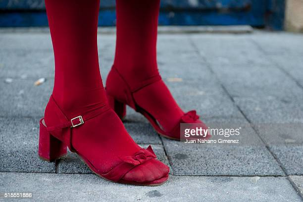 Ela wears Zendra shoes Calzedonia stockings Brigitte Bardot sunglasses and vintage handbag hat and coat on March 14 2016 in Madrid Spain