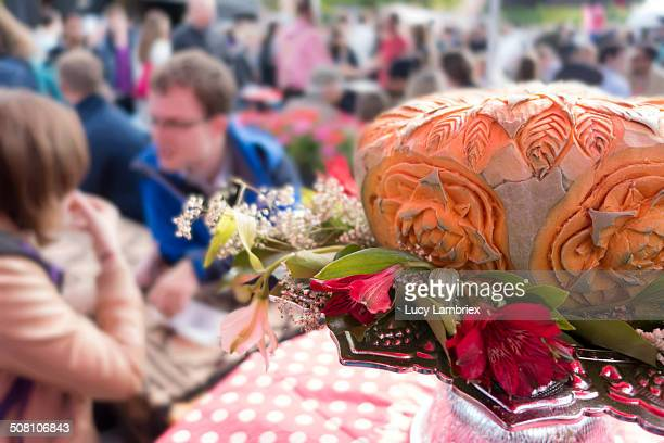 CONTENT] Elaborate and arty pumpkin carving at food festival 'Rollende Keukens' Amsterdam Large group of unrecognizable people at tables in the...