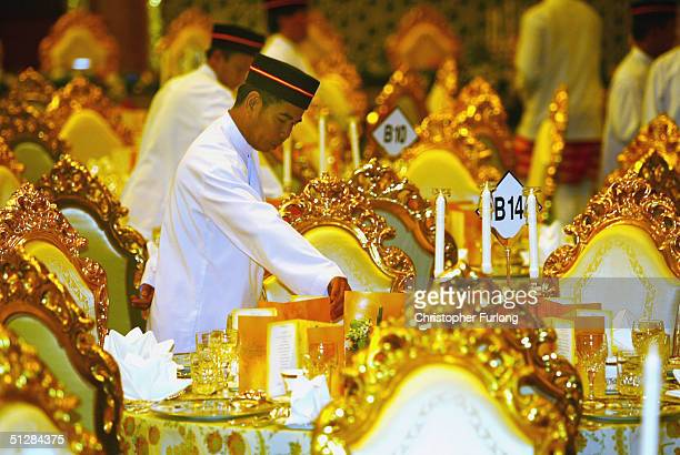 Elaborate gold place settings for the Persantapan Pengantin Diraja following the wedding of His Royal Highness Crown Prince AlMuhtadee Billah Bolkiah...