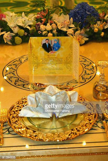 Elaborate gold place settings for the Prince and Princess at the Persantapan Pengantin Diraja following the wedding of His Royal Highness Crown...